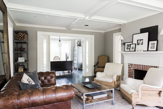 Modern farmhouse living room with fireplace and tufted leather sofa on Hello Lovely Studio