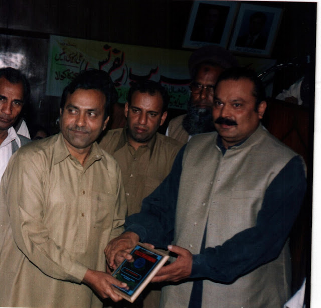 Arif Malik Son of Shams Malik receiving the award from Rana M. Qasim Noon
