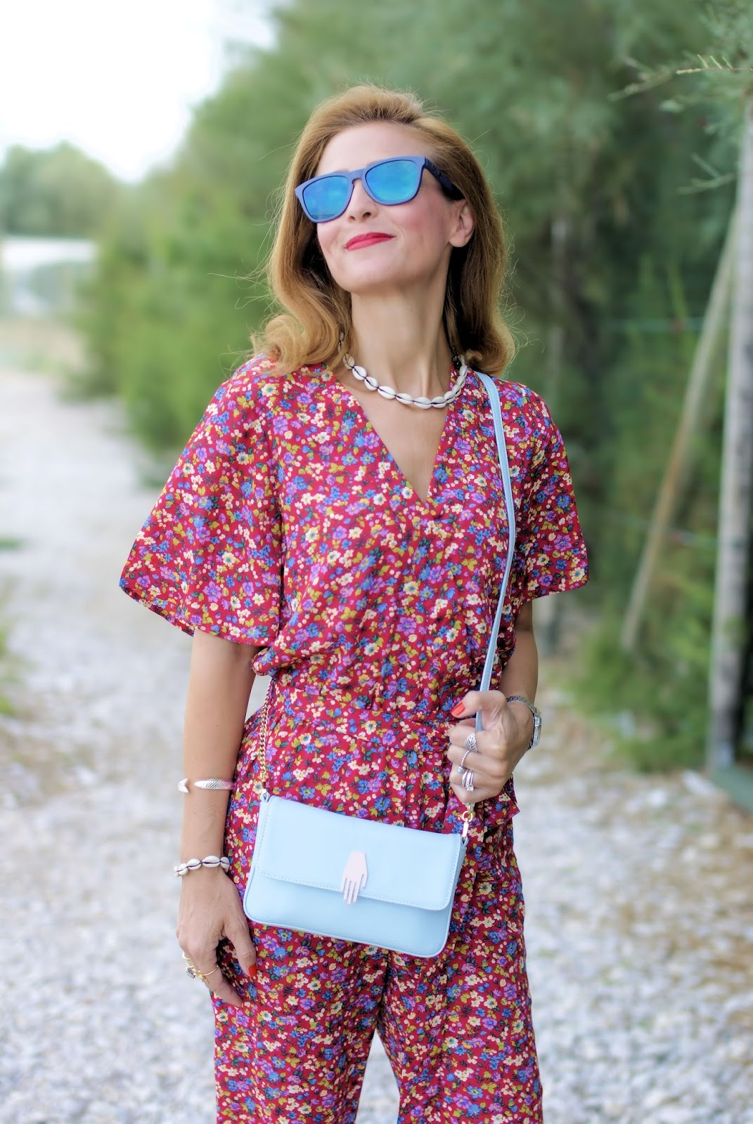 Floral jumpsuit and shell necklace on Fashion and Cookies fashion blog, fashion blogger style