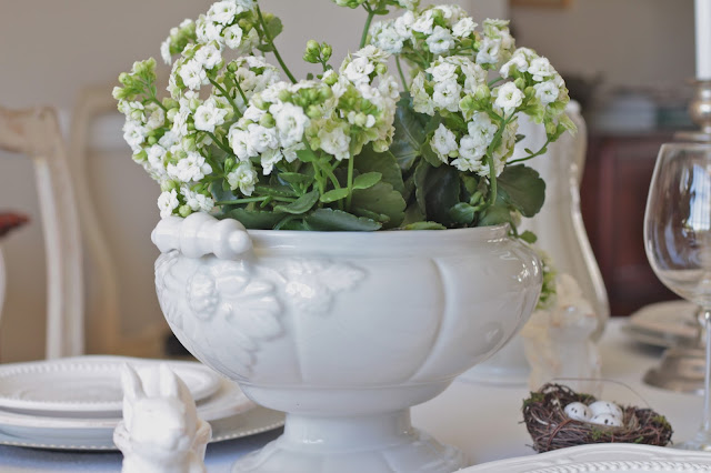 neutral easter tablescape centerpiece white flowers in white ironstone