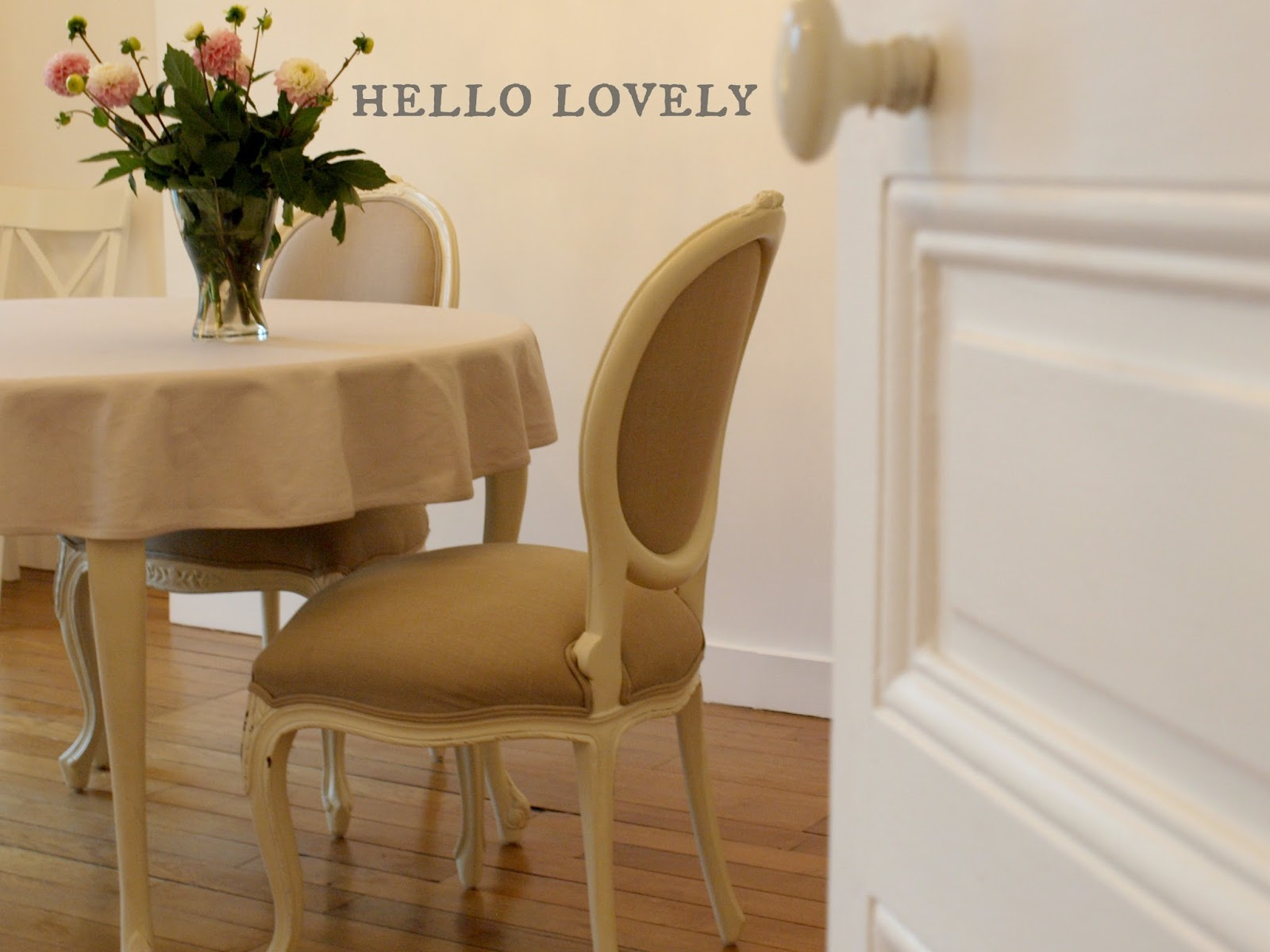 Dining room of our Paris apartment and beautiful white vintage door - Hello Lovely Studio