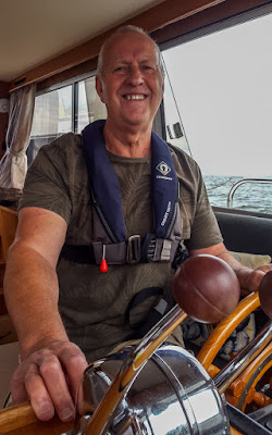 Photo of Phil at the helm on our first outing