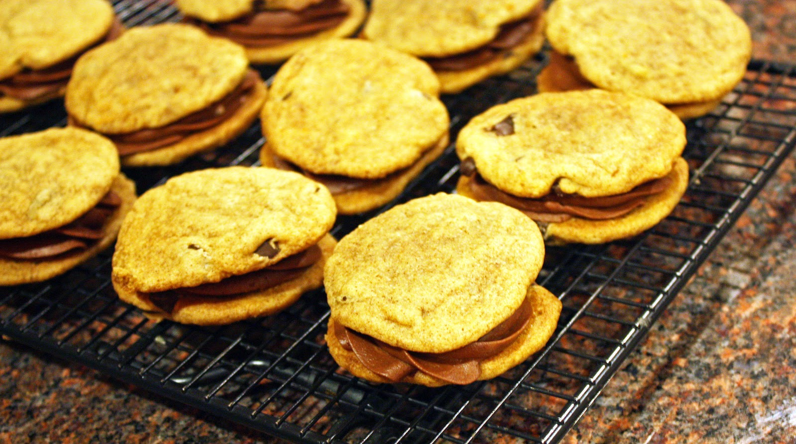 vegan chocolate chip pumpkin spice cookie sandwiches with chocolate buttercream