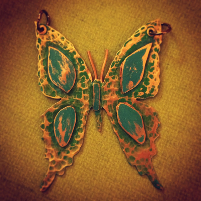 Copper Butterfly with green patina and texture added to it