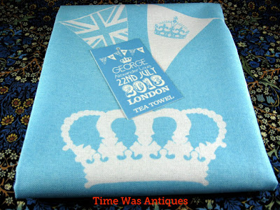 https://timewasantiques.net/products/tea-towel-prince-george-birth-william-kate-blue-and-white-2013-royal-birth