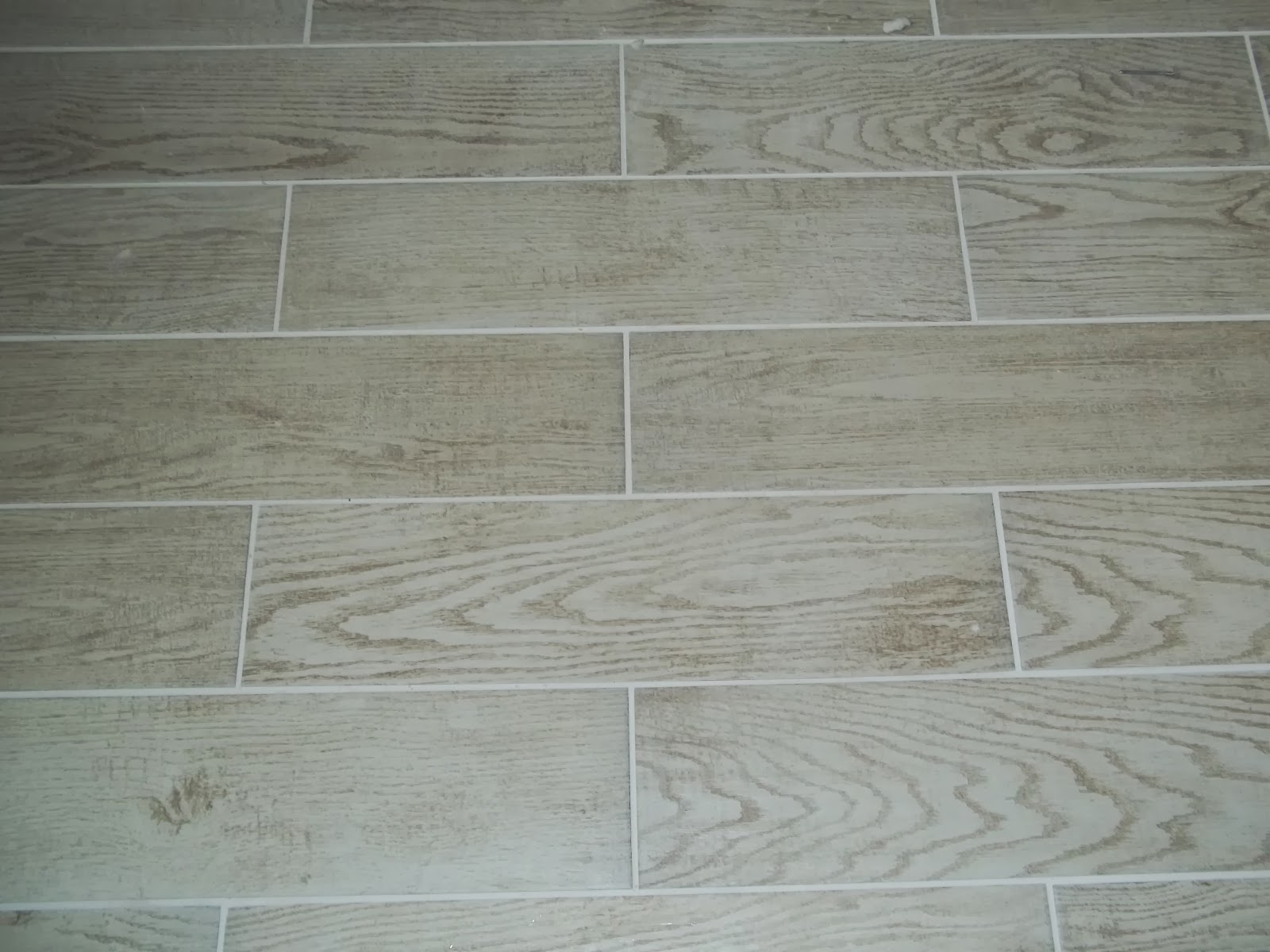 Tile Installtion FAQ  Sanded Grout or Un Sanded Grout    Ask Tile     Broke joint floor tile with a 3 16 grout joint with sanded grout