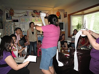 A family playing a game with tissue paper