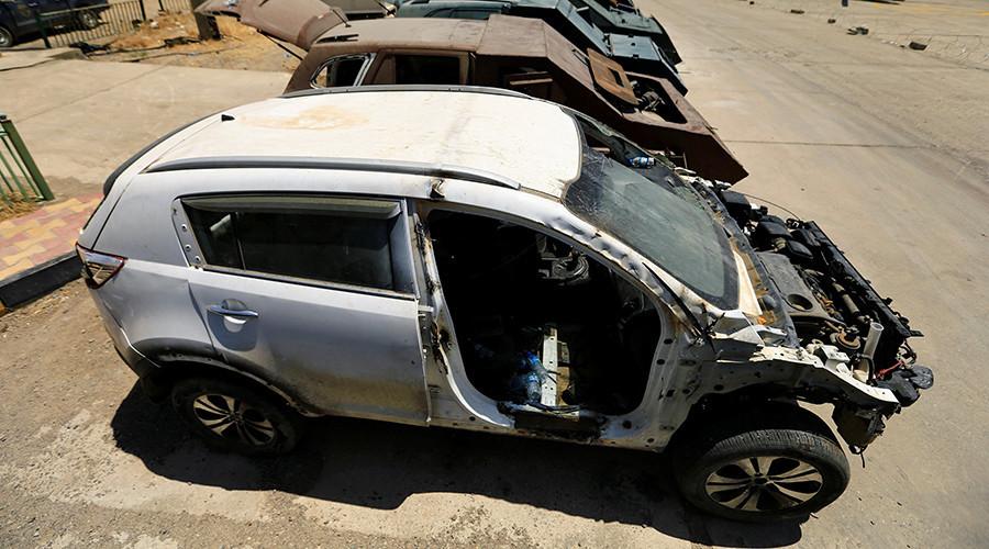 © Thaier Al-Sudani —  Source: Reuters— Une voiture désossée, prête à être blindée