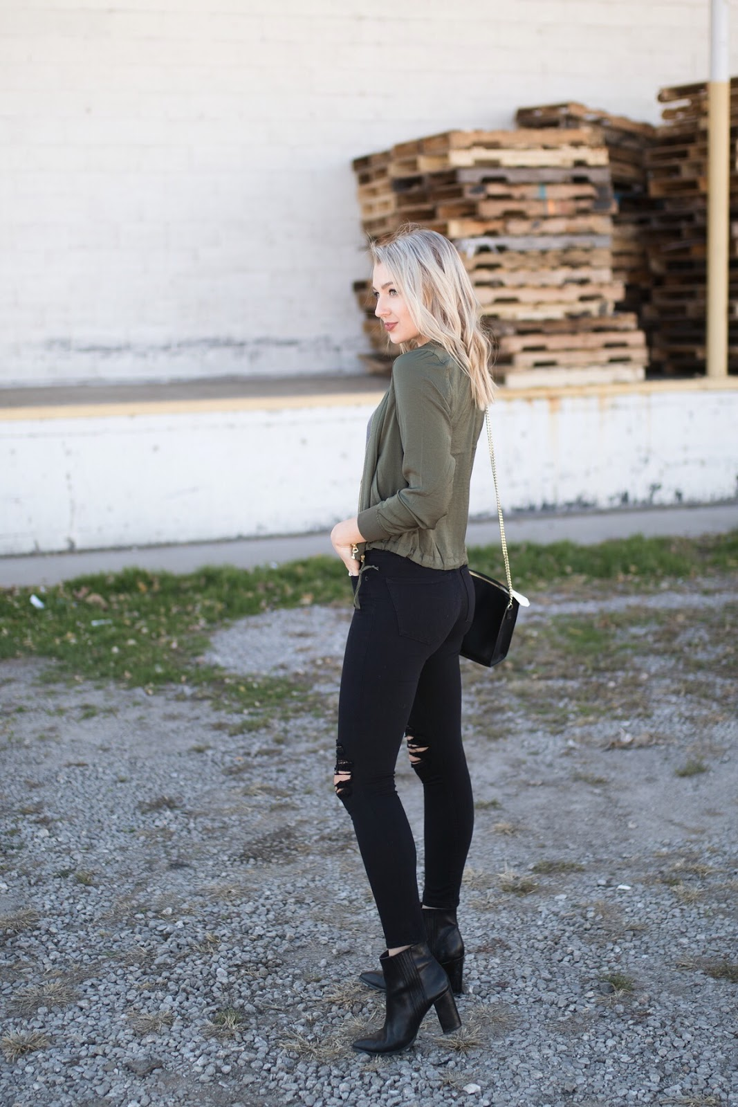 olive jacket with black skinny jeans