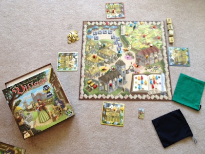 Village board game in play