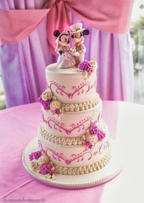 Tarta rosa con Mickey y Minnie