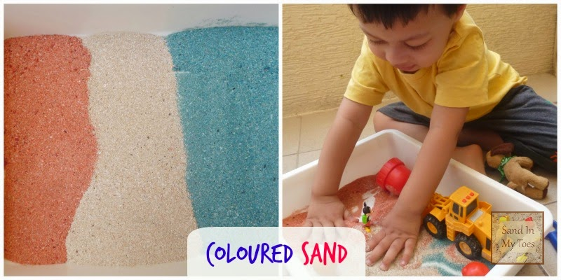 Playing with coloured sand