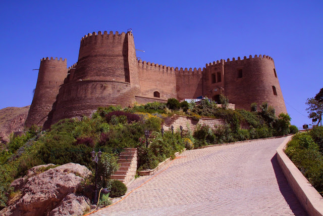 The ancient stone and brick made Falak ol Aflak castle located on a hill.