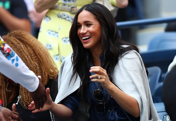 Meghan Markle wore a new denim belted shirt dress by J.Crew, and also wore a grey collarless sweater blazer by the same brand