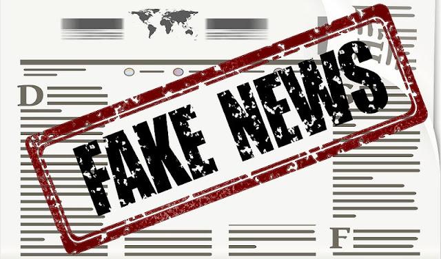 ilustrasi berita hoax dengan stempel bertuliskan fake news