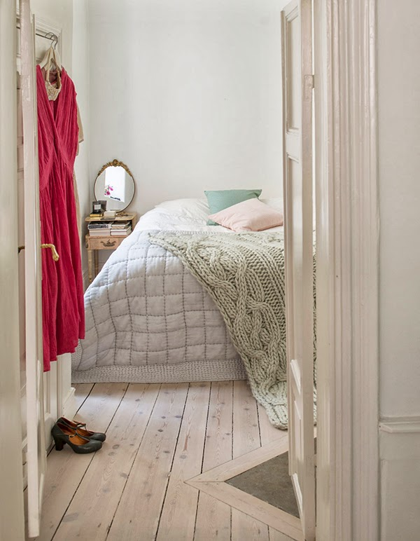 Cozy vintage style bedroom with raw wooden floors