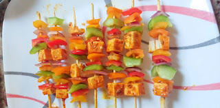 the cheese and vegetables are threaded onto mini bamboo skewers