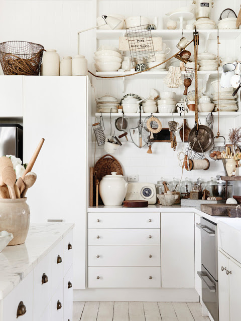 Rustic eclectic kitchen with white cabinets and vintage style by Kara Rosenlund - found on Hello Lovely Studio