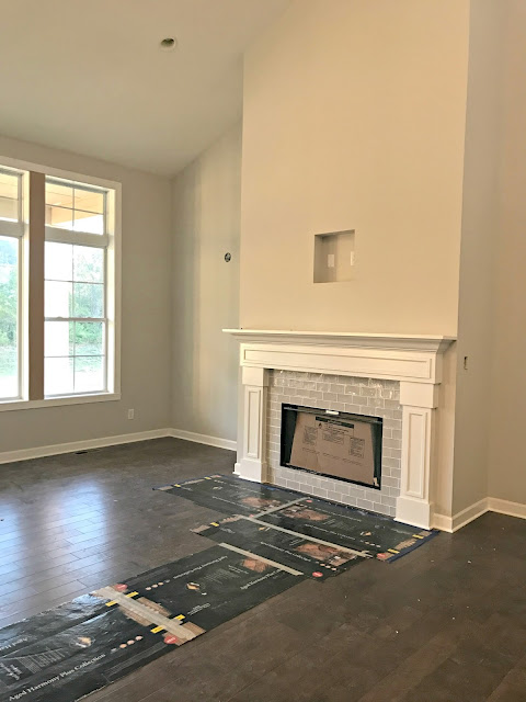 White fireplace with gray tile surround