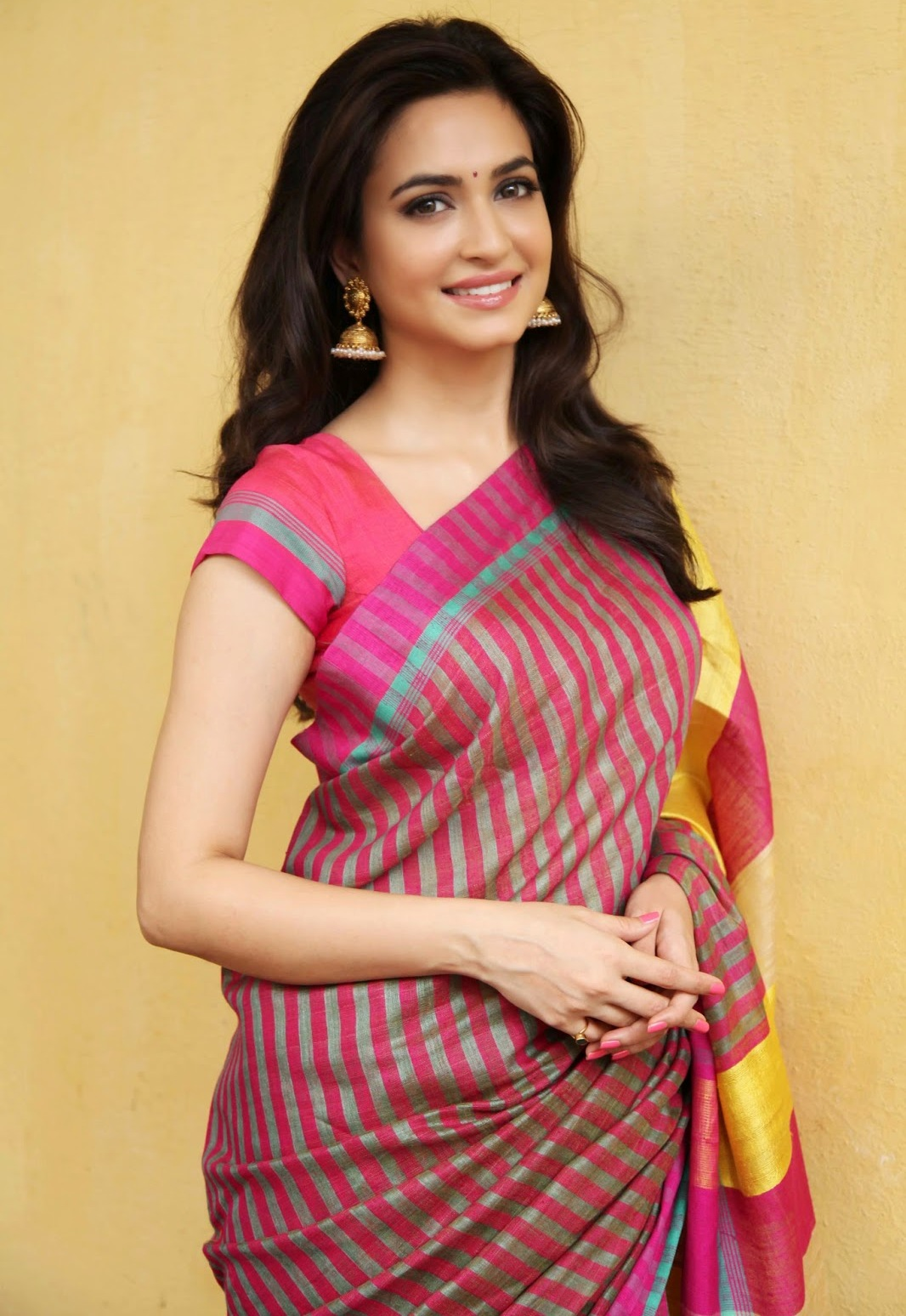 Telugu Hot Girl Kriti Kharbanda Hip Navel Show Stills In Designer Red Saree