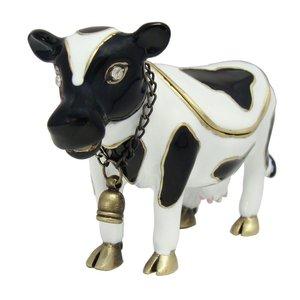 Una pequeña estatuilla de vaca.