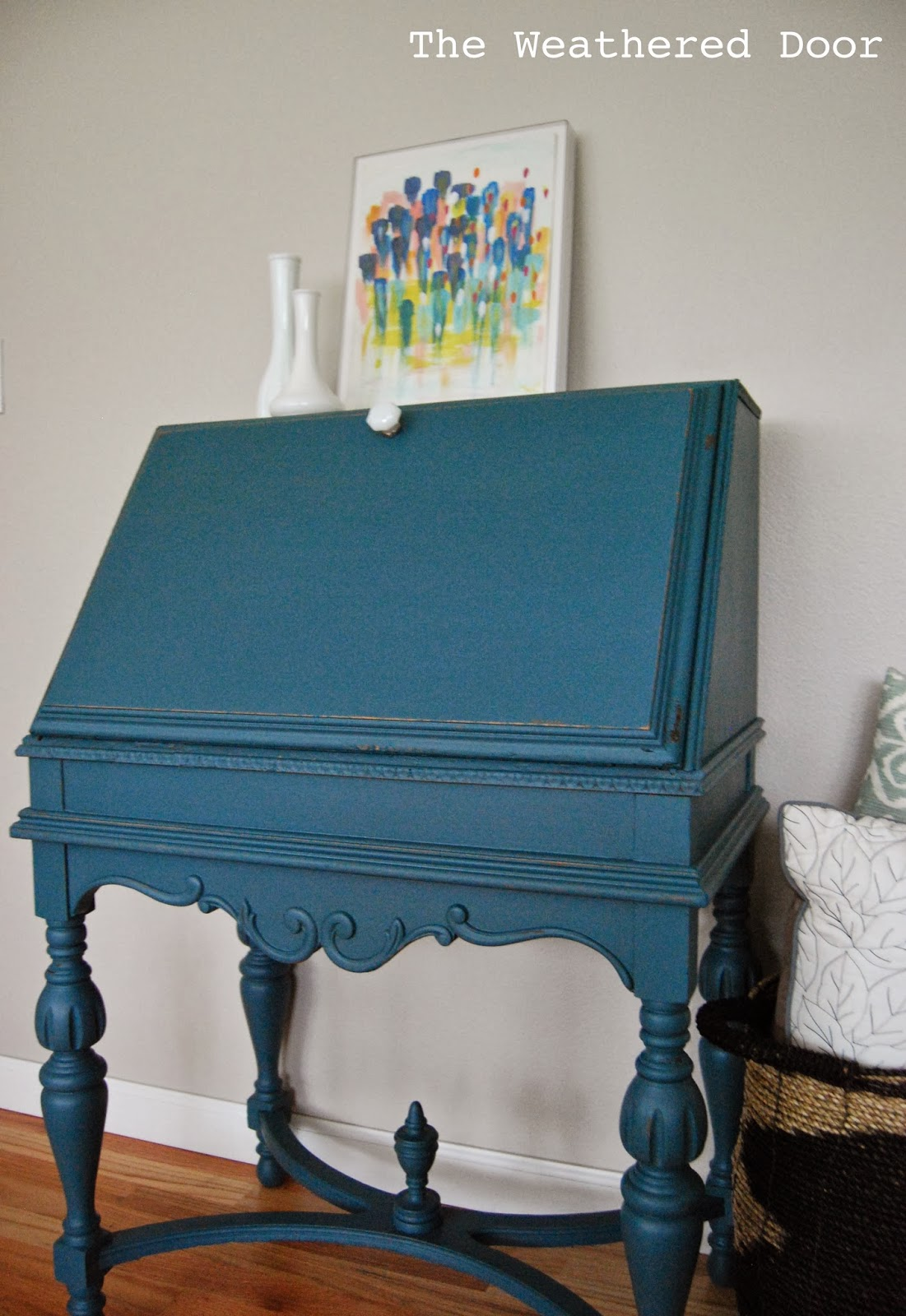 An antique secretary desk in a deep teal  The Weathered Door