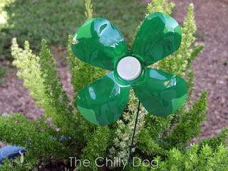 Kid's Craft Tutorial: Add some luck to your garden with DIY recycled plastic water bottle shamrocks for St. Patrick's Day or any day.