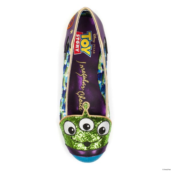 single shoe from top view showing purple insole and green glitter alien face across toe