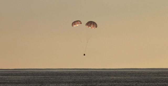 The SpaceX Dragon is pictured seconds before splashing down in the Pacific Ocean. Photo Credit: SpaceX