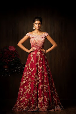 This amarant purple wedding gown has a fully encrusted bodice with resham.