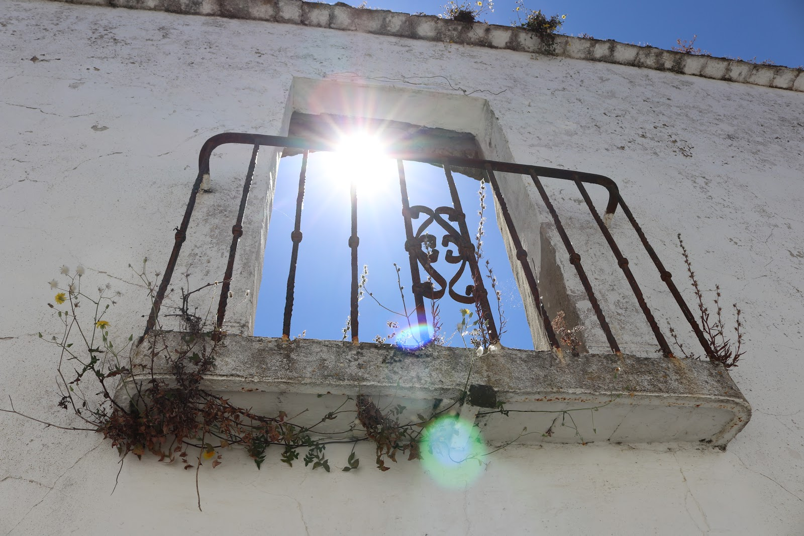 Sun streaming through a balcony in Spain