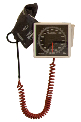 A hospital blood pressure cuff mounted on the wall.