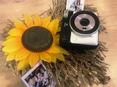 Instax SQ6 flatlay with sunflower