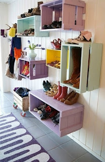 Nail painted crates to the wall for colorful display shelving