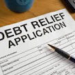 What steps do I need to take to apply for debt counselling or debt review?