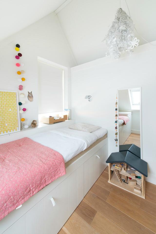 Habitación infantil para una niña con escondite