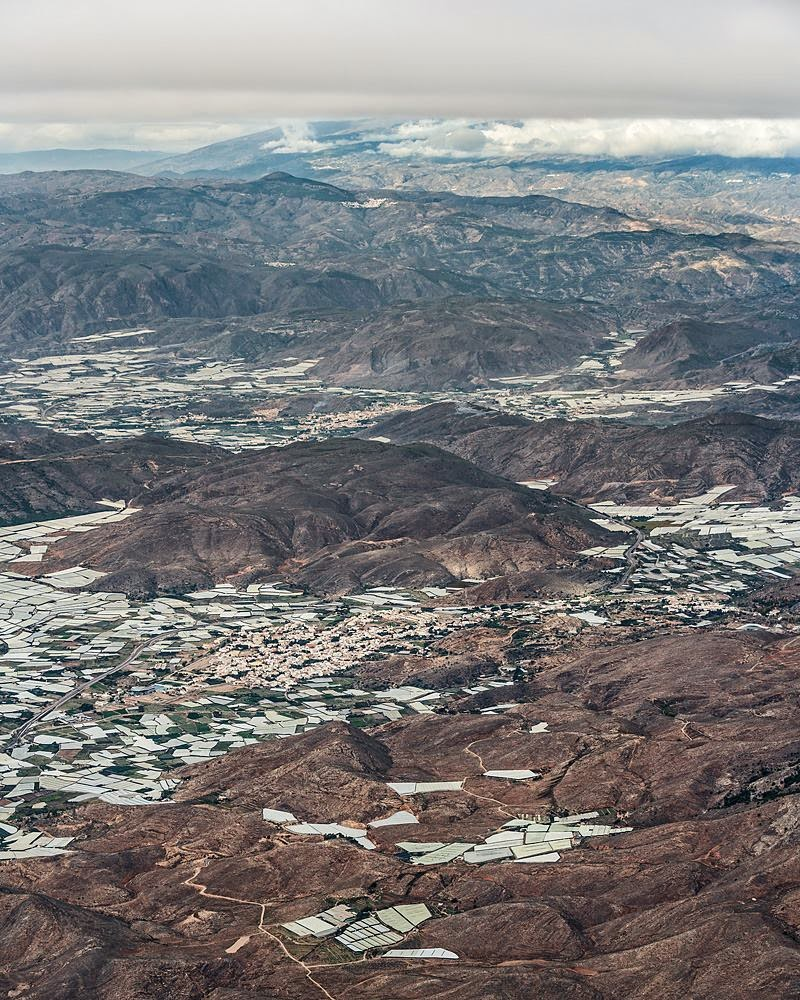 """ Aerial View of Plastic Sea "" , a wonderful series of aerial photographs taken in November 2014 by Bernhard Lang, of the ""Sea of Plastic"" -  Agriculture Greenhouse in the region of Almería, southern Spain. Campo de Dalías, some 30 km southwest of the city of Almería in southern Spain. Almería has become Europe's market garden and grow fruit and vegetables all year, the land is shaded in plastic sheet."