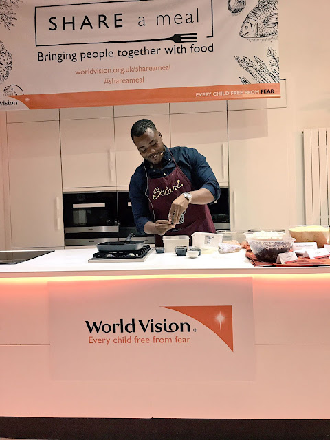 Selasi cooking at the World Vision share a meal launch