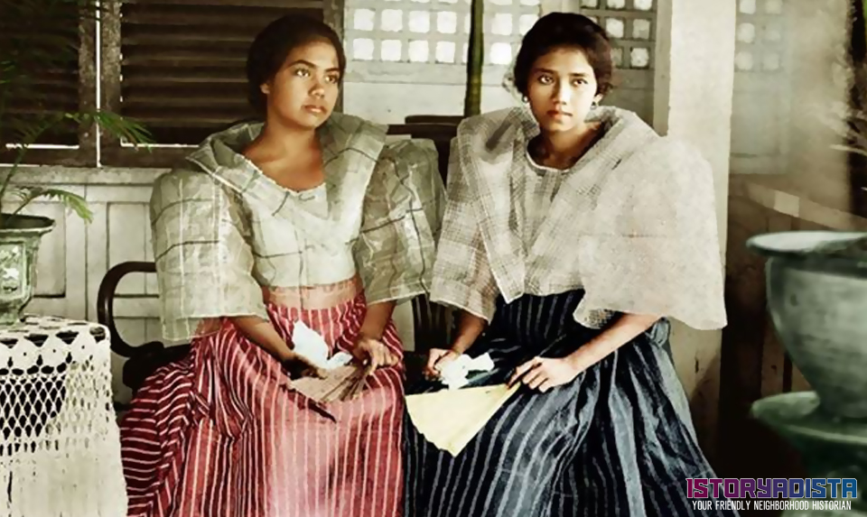 Filipino women at an old bahay na bato (c1900s)