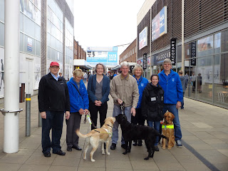 Cllr Tony Davis and Claire Young with Guide Dogs' representatives and three dogs in Yate Shopping Centre