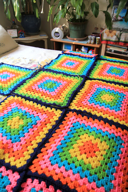 Rainbow crochet granny square blanket project.