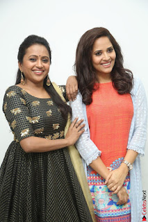 Actress Suma in Black Salwar Suit and Anusuya in orange Dress at winner movie press meet part 1 February 2017 (40).JPG