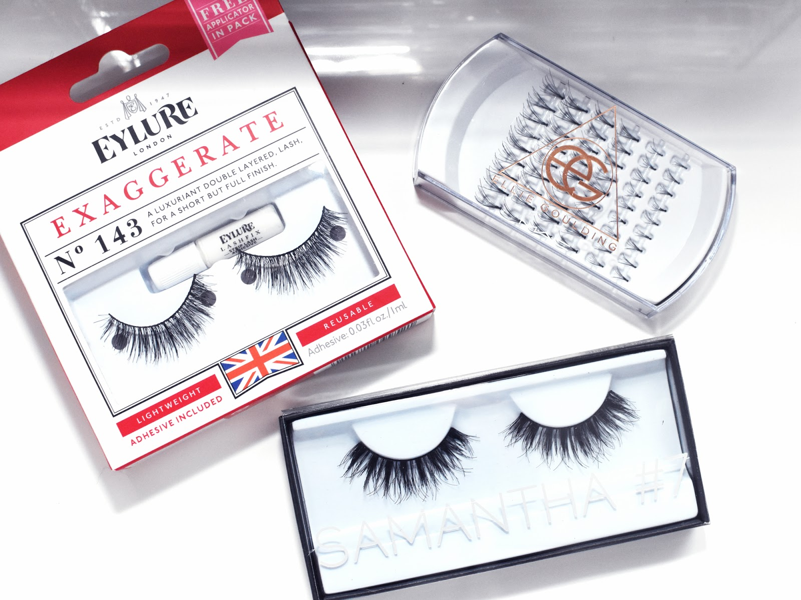 An assortment of false eyelashes from Eylure, Huda Beauty, and Ellie Goulding for MAC