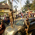 Commotion as two men suddenly strip and dance around naked after stealing car