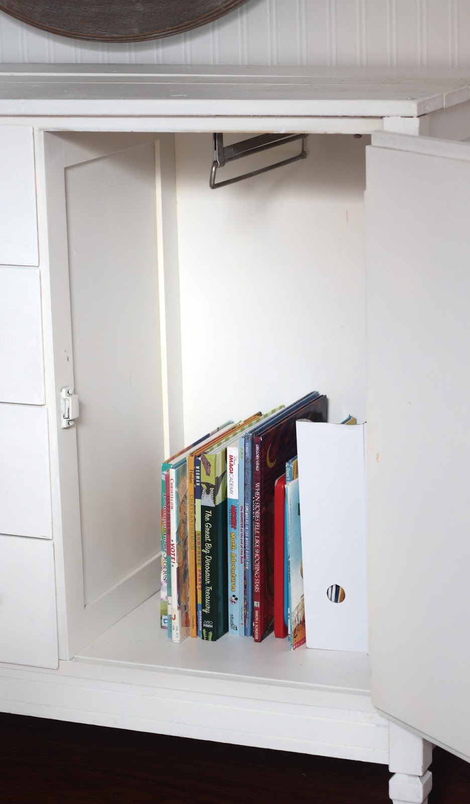 book organization in white cabinet