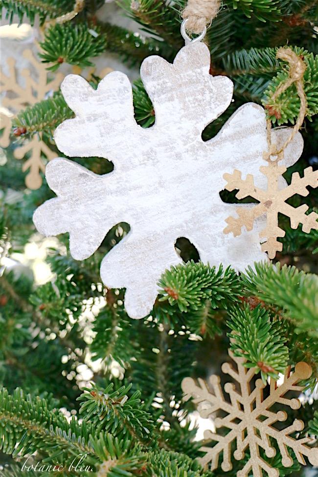 white-wood-snowflake-ornament-on-christmas-tree