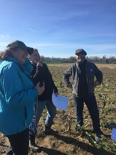 Lainie & John share a laugh with farmer-cooperators