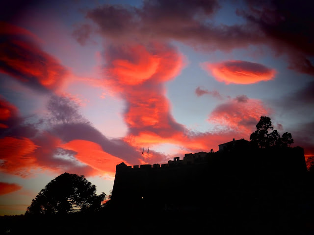 very colorful clouds over the fortress