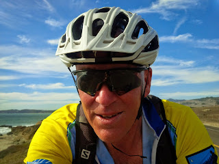 A cyclist riding along the coast in San Francisco