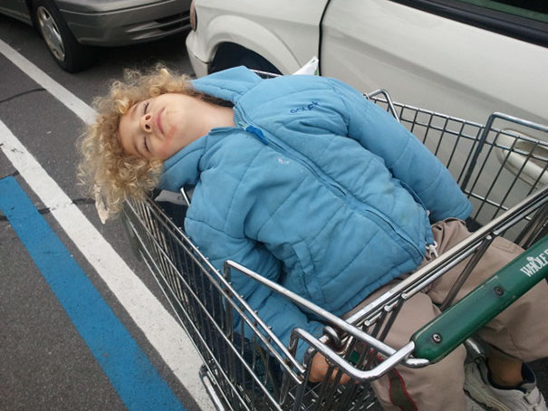 15+ Hilarious Pics That Prove Kids Can Sleep Anywhere - Napping In A Shopping Cart